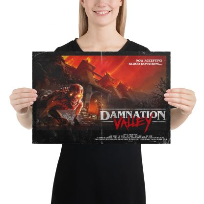 Female model holding Damnation Valley small poster