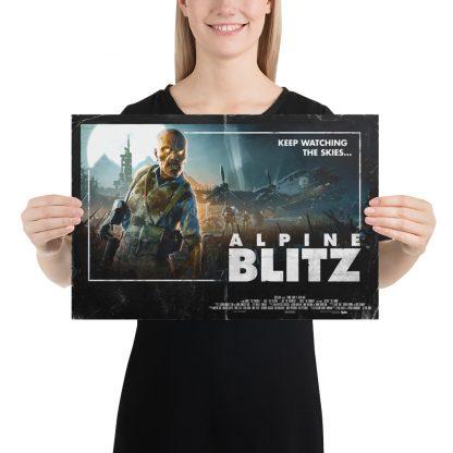 Female model holding Alpine Blitz small poster