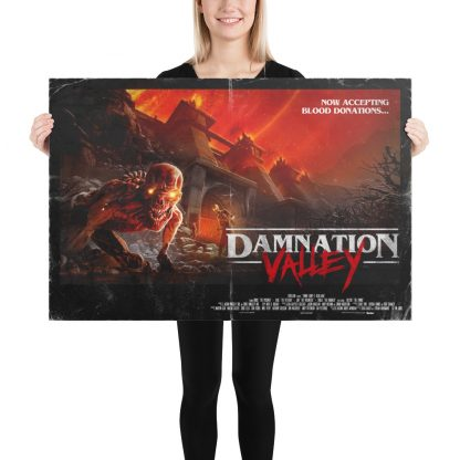 Female model holding Damnation Valley large poster