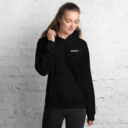 Black hoodie worn by female model with Gods logo in gold